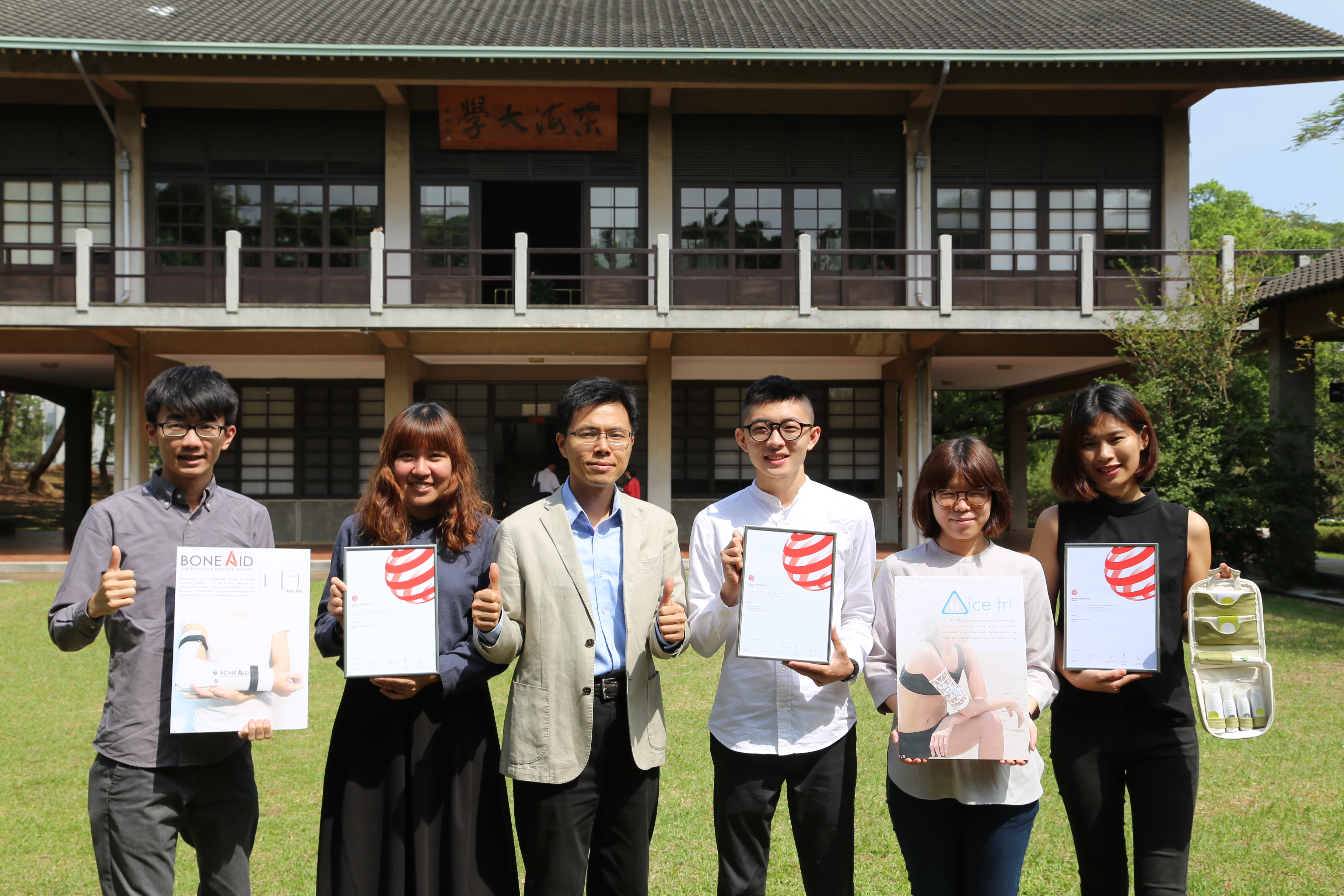 Students displayed their award-winning designs with the department Chair Dr. Yao-Tsung Ko